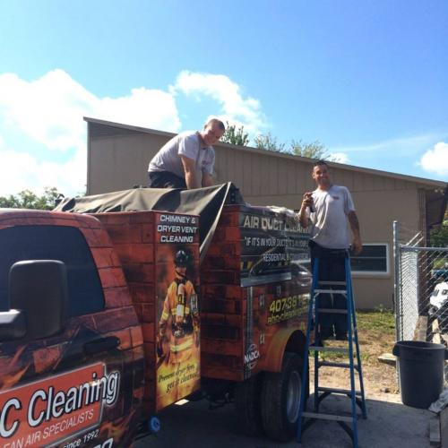 team cleaning duct truck